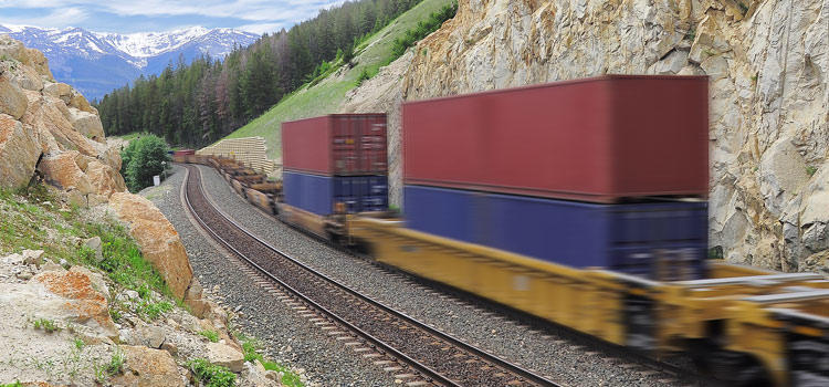 image of a train carrying cargo