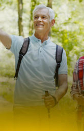 image of two seniors hiking and pointing at something