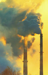 image of industrial chimneys polluting