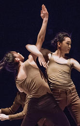 image of two women dancing on a stage