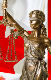 Lady Justice in front of a Canadian flag