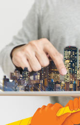 A person holding a city and pointing