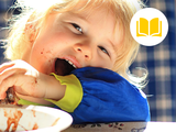 image of kid eating and making a mess