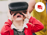 photo of kid using a vr