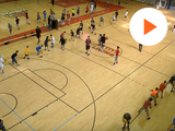 picture of a basketball court and kids playing in it