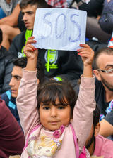 image of child holding and SOS sign