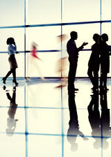 photo of several people waling in an office space