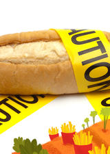 A loaf of bread wrapped in caution tape
